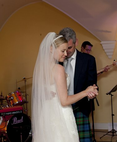 Newlyweds dancing at Mellerstain House