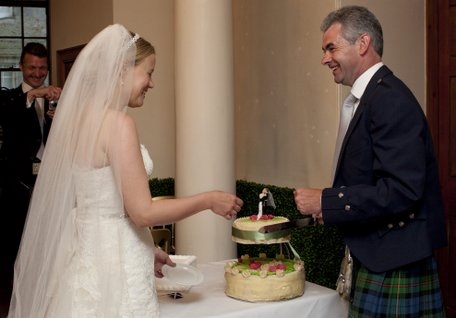 Cutting the wedding cake at Mellerstain